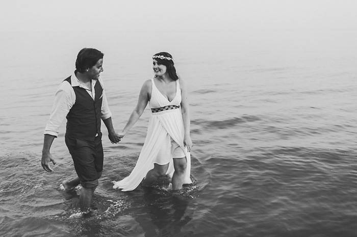 bride and groom walking in the water