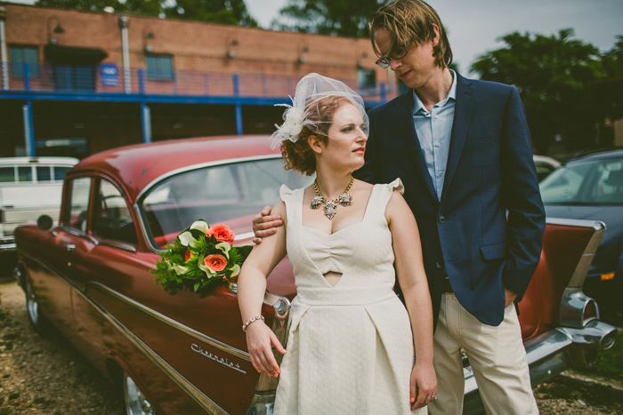 wedding portrait in front of car