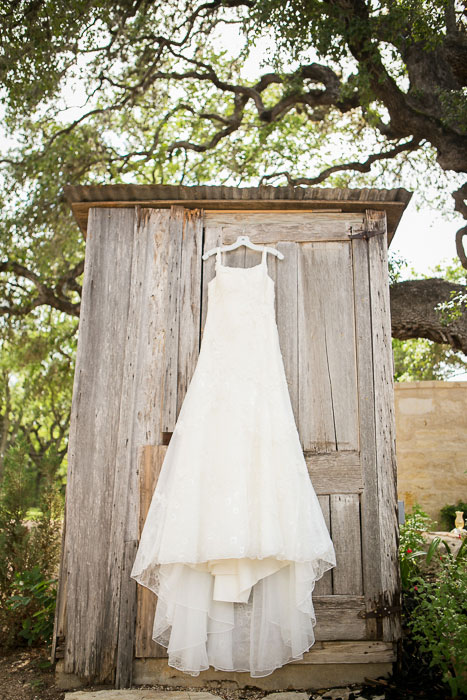 wedding dress hanging up outdoors
