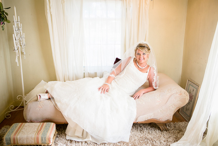 bride lounging on chaise