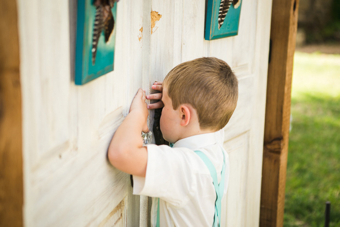ring bearer peeking through doors