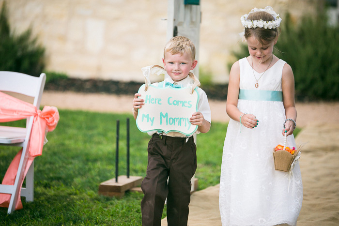 ring bearer and flower girl walking down aisle