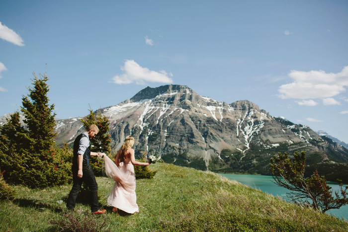 bride and groom walking through Alberta National park