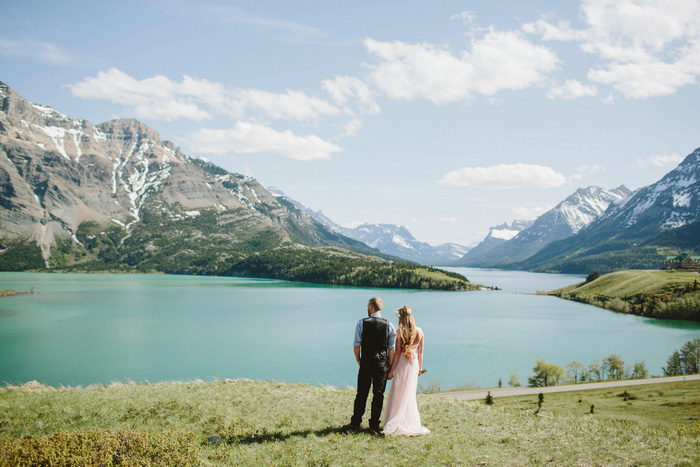 bride and groom portrait by turquoise lake