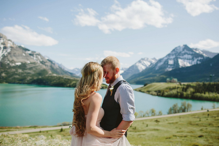 bride and groom by Alberta lake