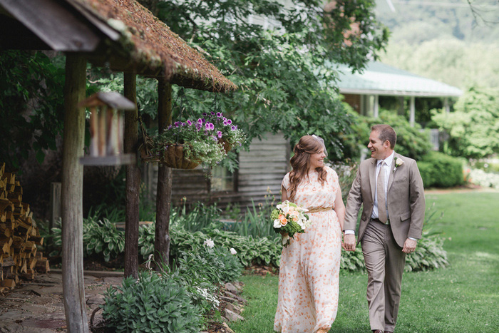 bride and groom walking on farm grounds