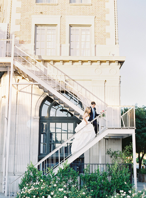 bride and groom climbing fire escape