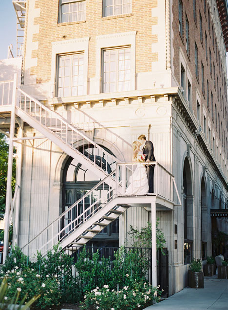 bride and groom on fire escape
