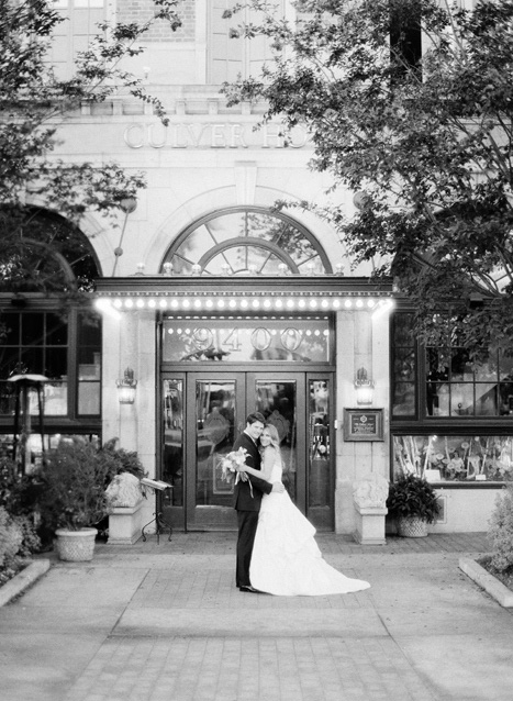 bride and groom in front of Culver Hotel
