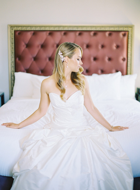bride sitting on hotel bed