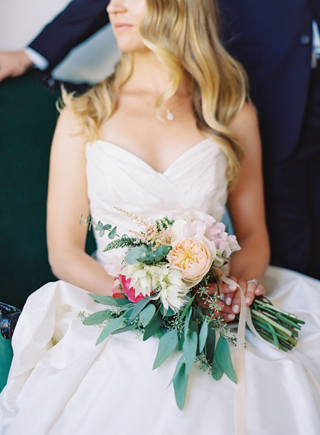 bridal bouquet on bride's lap