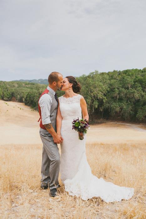bride and groom kissing on farm