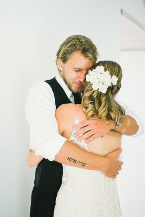 emotional groom hugging bride