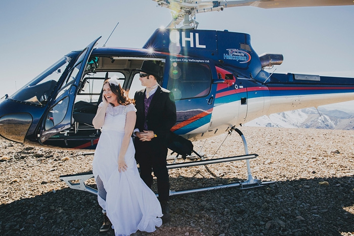 bride and groom exiting helicopter