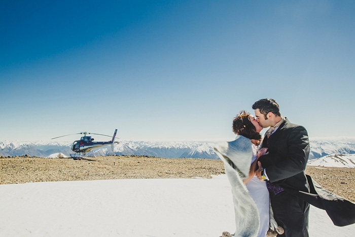 bride and groom on snowy New Zealand mountain