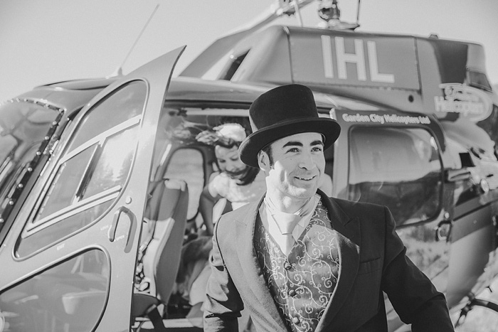 groom in top hat exiting helicopter