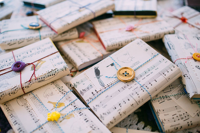 sheet music wrapped guest favors