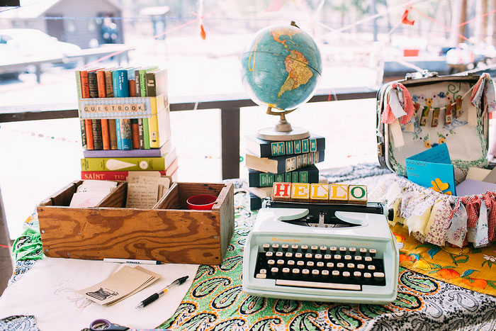 typewriter and globe wedding decor