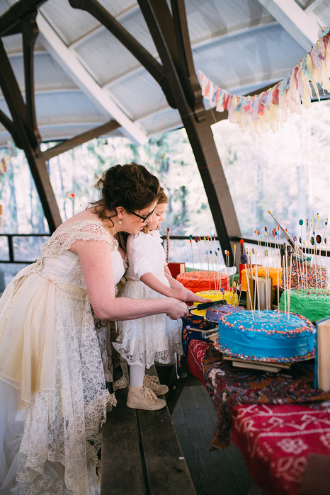 bride cutting cake with flower girl