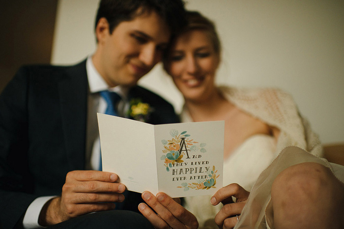 bride and groom reading card