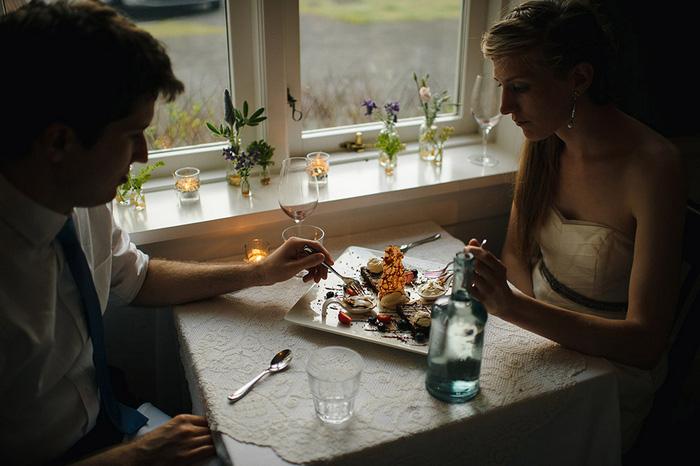 bride and groom eating dinner