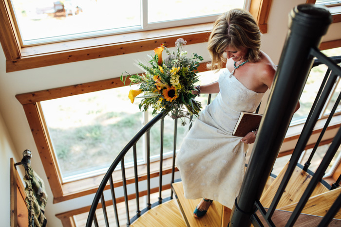 bride walking down cabin staircase