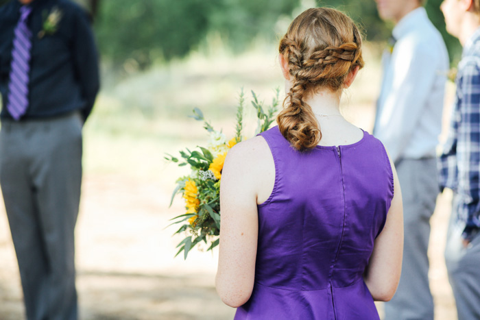 maid of honor in purple dress