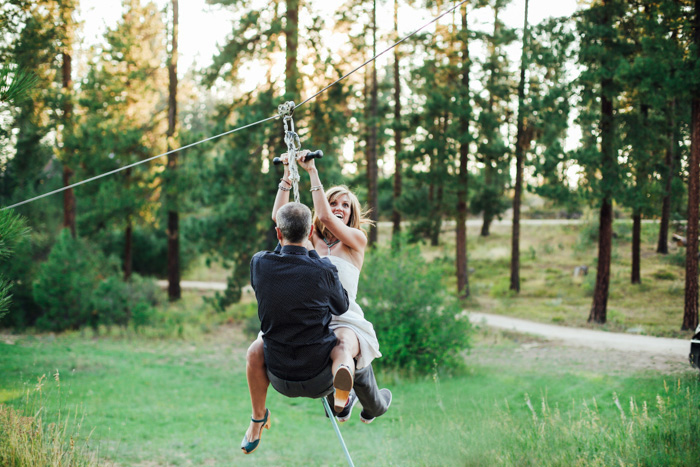bride and groom zip lining