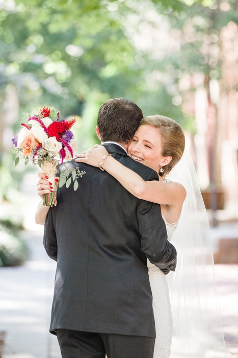 bride and groom hugging at first look