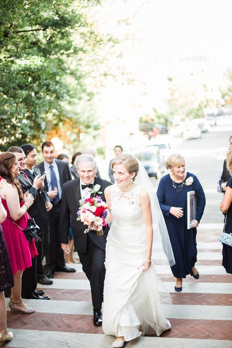 bride walking up steps with father