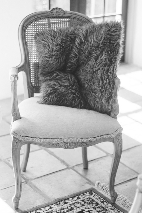 chair with faux fur pillow