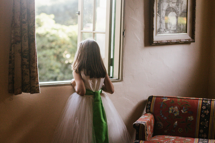 flower girl looking out window