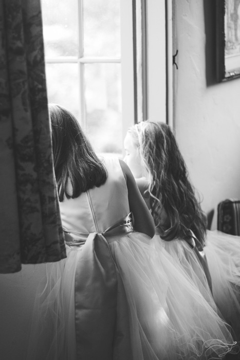 flower girls looking out window