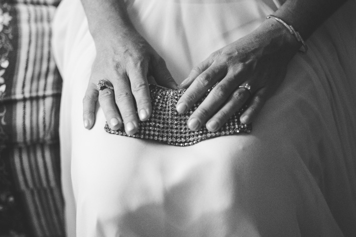 bride holding clutch