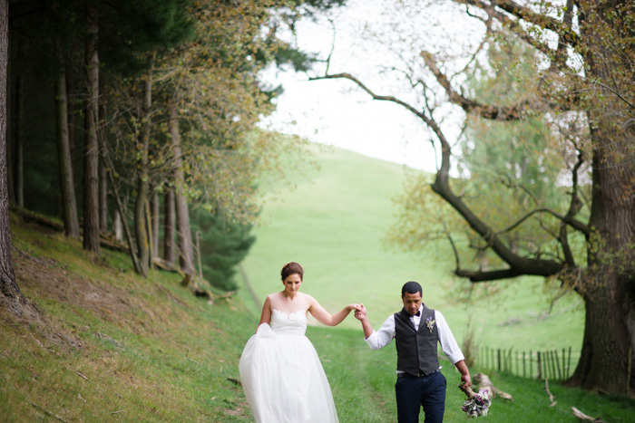 bride and groom walking outdoors