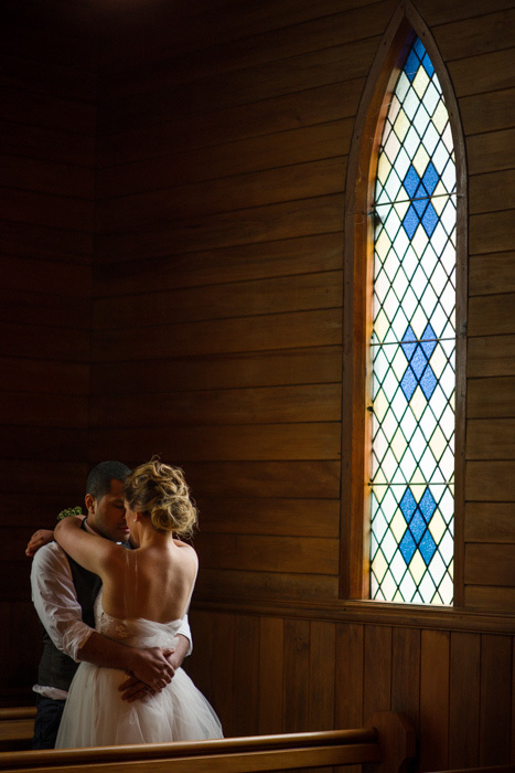 bride and groom hugging in church