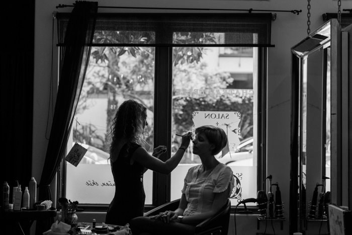 bride getting make-up done