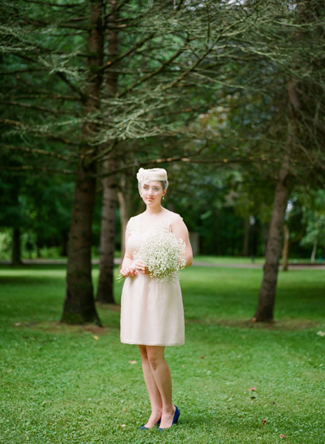 bride in pillbox hat and short wedding dress