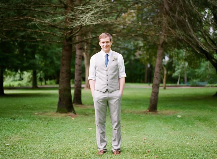 groom in vest and blue tie