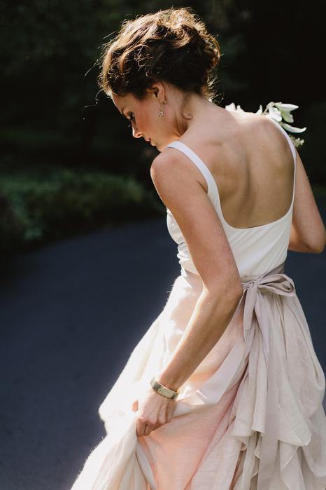 bride adjusting dress