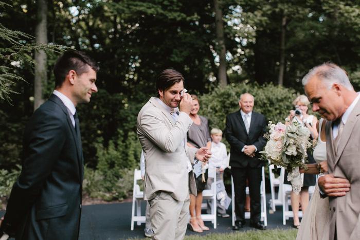 emotional groom at the altar