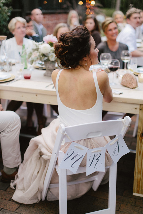 bride with Mrs. sign on her chair