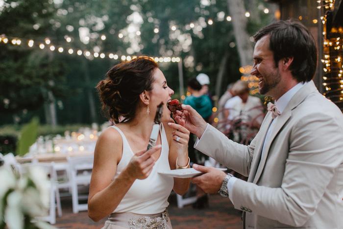 groom feeding bride chocolate covered strawberry