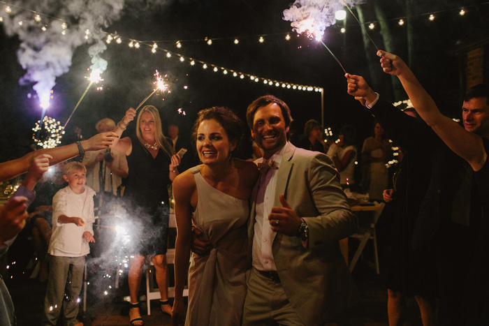 bride and groom with sparkler send-off