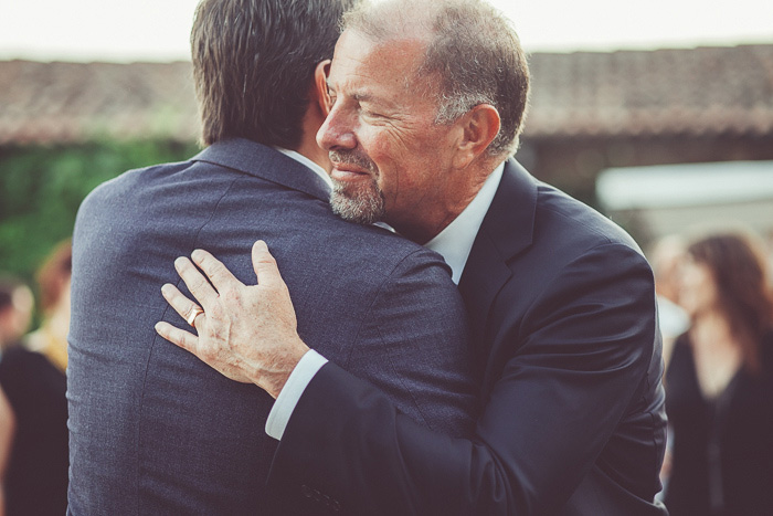 groom hugging father-in-law