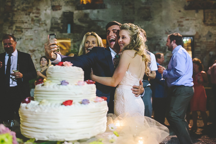bride and groom taking selfie
