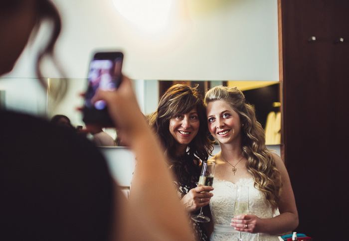 bride and mother having photo taken