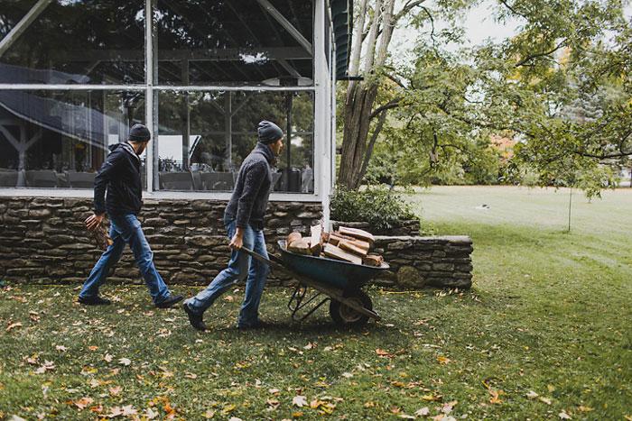pushing wheelbarrow full of lumber
