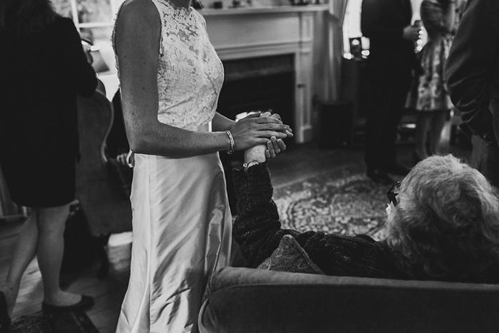 bride holding grandma's hand