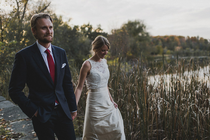 bride and groom walking in country